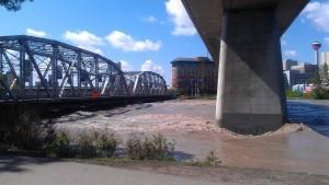 Rushing river over bridge.