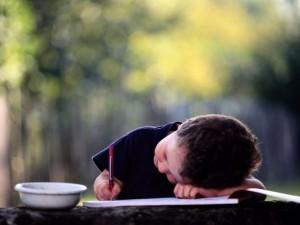 Kid writing.