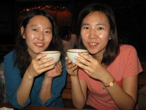 Sun-Mi and Suzan drinking rice wine.