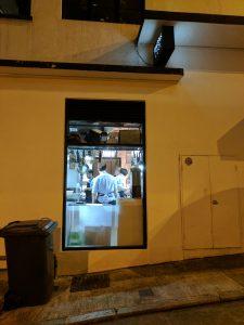 Chefs at work at a restaurant on Hollywood Road, Hong Kong.