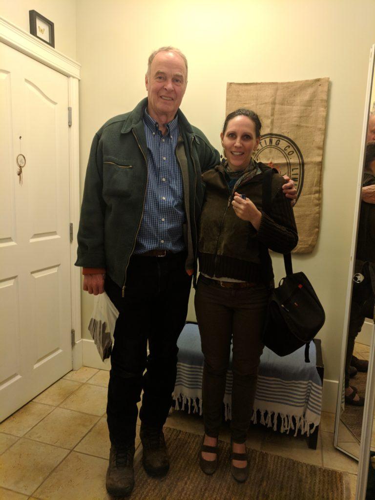 Alex and Lea in the foyer of a condo building in Edmonton, Alberta.