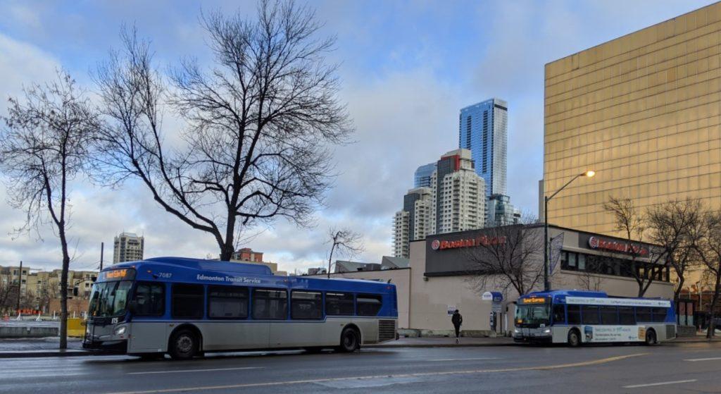 Edmonton buses picking up passengers on Jasper Avenue.